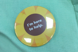 """I'm here to help"" colleague badge"
