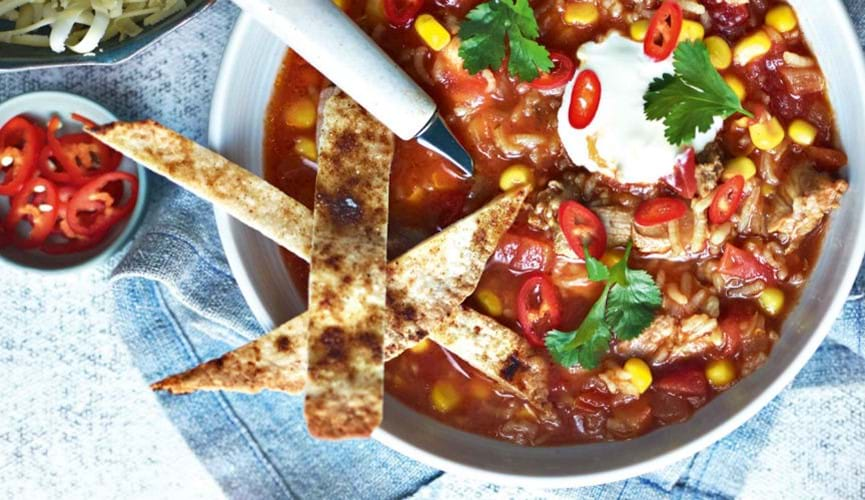 Chicken enchilada soup with crispy tortillas
