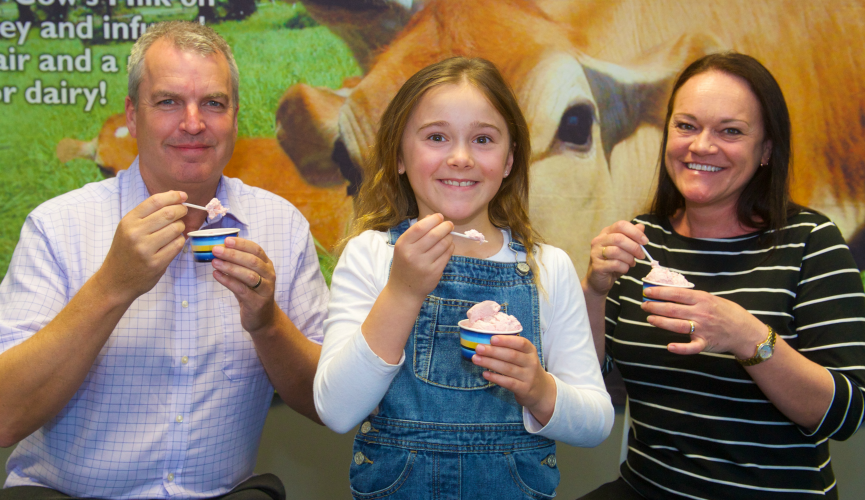 Jersey Dairy's Alan James, with Tayla and Angela Jeanne, the competition winner.